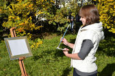 Charming artist in a park — Stock Photo