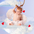 Cute angel baby with bow and arrow, sitting on a cloud — Stock Photo #7661981