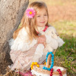Beautiful little girl with a basket in anticipation — Stock Photo