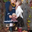 Two cute girls, sisters, standing, holding hands. — Stock Photo