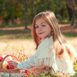 Beautiful little girl with basket in anticipation. — Stockfoto #7950475