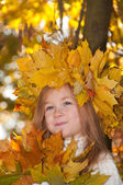 Cute smiling girl in a wreath of red viburnum on the head and with a bouque — Stock Photo