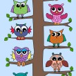 Lot of owls sitting in a tree — Stock Vector #7883810