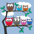 Colorful owls tree branch — Stock Vector #7900589