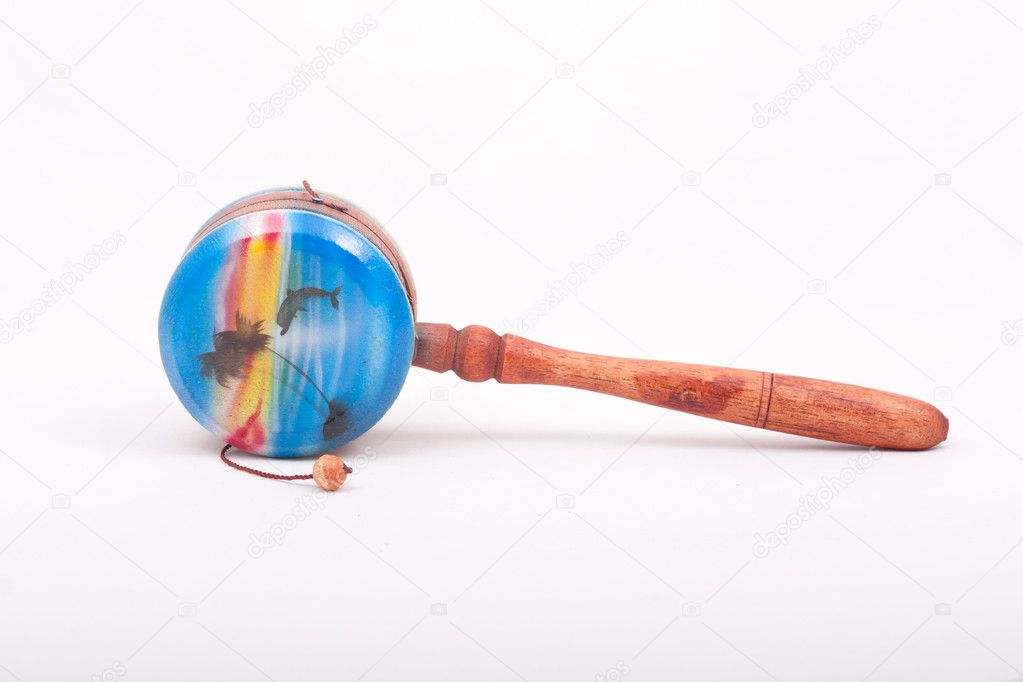 Blue instrument tambourine with beads on a string, , drum ratchet — Stock Photo #7693784