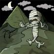 Scary cartoon Egyptian mummy in front of pyramids — Stock vektor
