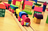 Toy Train in brick town — Stock Photo
