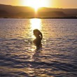 Girl Bathing at Sunset — Stock Photo #7776046