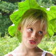 Portrait of a blonde girl with extraordinary Headdress - Stock Photo