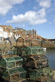 Crail harbour and lobster pots — Stock Photo