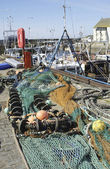 Fishing nets and buoys with harbour scene at Pittenweem — Stock Photo