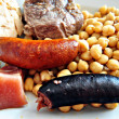 Garbanzos con embutidos - Stock Photo