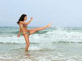 Woman splashing in the sea — Stock Photo