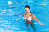 Girl stands in the pool — Stock Photo