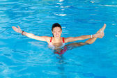 Woman Stretch in water — Stock Photo