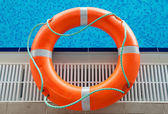 Rescue in swimming pool — Stock Photo