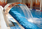 Waterfall in the swimming pool — Stock Photo