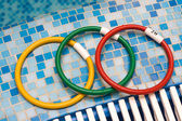 Water Toy Ring Cogs in swimming pool — Foto de Stock