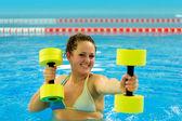 Woman in aqua aerobic — Stock Photo