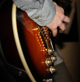 Fingers on guitar — Stock Photo