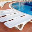 Lounge chairs near the pool — Stock Photo