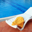 Stock Photo: Relax chair near pool with towel