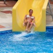 Girl sliding on water slide — Stock Photo #7880574