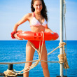 Girl with life saving buoy on pier — Stock Photo