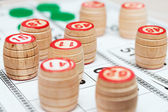 Lotto cards and small lotto-casks with figures — Stock Photo