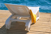 Lounge chair near the sea — Stock Photo