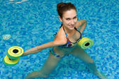 Girl in aqua fitness aerobic — Stock Photo