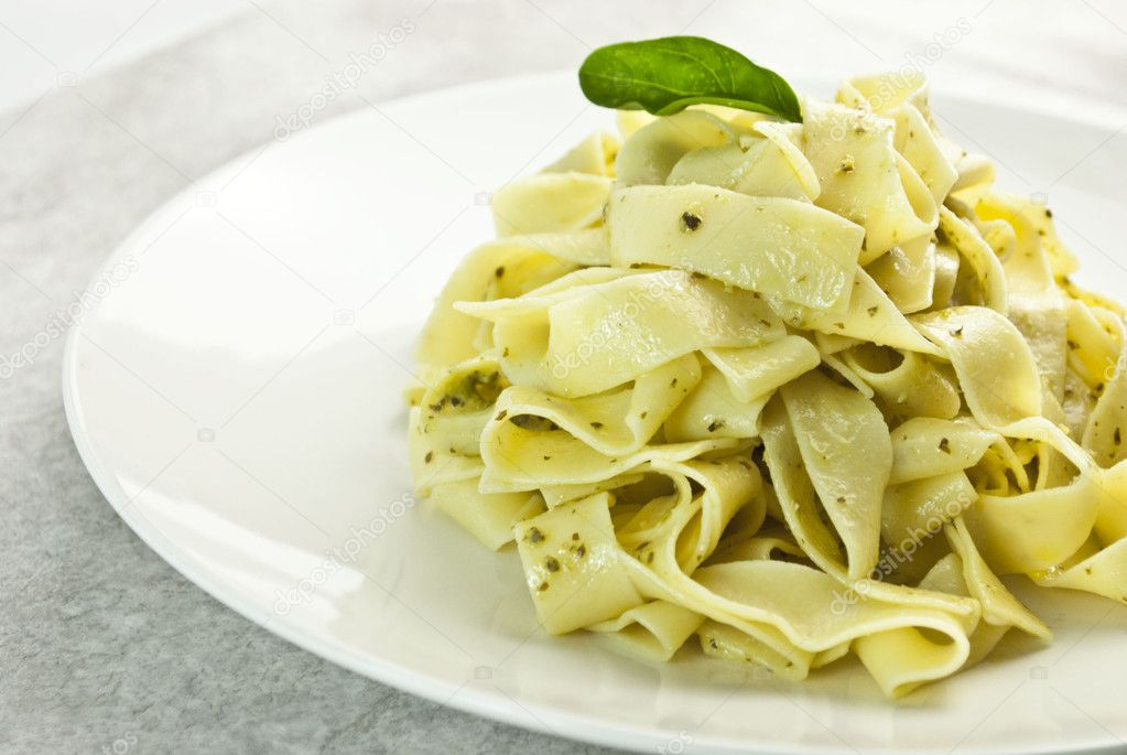 Pappardelle pasta with pesto on plate  Stock Photo #7792968