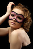 Romantic beautiful woman with a mask — Stock Photo