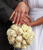 Holding a wedding bouquet — Stock Photo