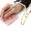 Womans hand with pen — Stock Photo