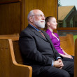 Stock Photo: Older White MYounger WomSitting Church Pew