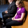 Senior White Man Young Woman Praying in Church Pew — Stock Photo #7893336