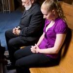 Senior White Man Young Woman Praying in Church Pew — Stock Photo
