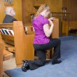 Caucasian Woman Kneeling Crossing Herself Church - Stock Photo