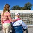 Grandfather Granddaughter Wheelchair WWII Memorial - Stock Photo