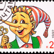 Canceled Russian Postage Stamp Pinocchio Puppet Holding Gold Key - Stock Photo