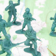 Plastic Army Men Fighting Battle Topographic Map - Stock Photo