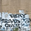 Stock Photo: Every Second Counts Graffiti on Cement Wall