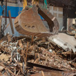 Stock Photo: Demolition Equipment Claw, Pile of Debris at Work Site