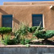 Exterior View of Adobe House Wall Santa Fe, New Mexico - Stock Photo