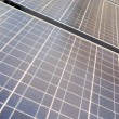 Stock Photo: Diminishing Rows Blue Photovoltaic Solar Panels