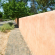 Adobe Wall to a Vanishing Point Sidewalk Santa Fe — Stock Photo