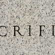 "Word ""Sacrifice"" Carved in Gray Granite Stone — Stock Photo #7895162"