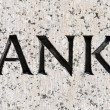"Stock Photo: Word ""Tanks"" Carved in Gray Granite Stone"