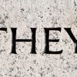 "Word ""They"" Carved in Gray Granite Stone — Stock Photo"
